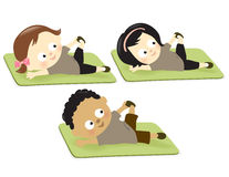 Kids exercising on mats Stock Photos