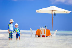 Kids at exotic island picnic Royalty Free Stock Photo