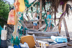 Kids exploring beach hut Royalty Free Stock Photos
