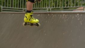 Kids extreme leisure rollerblader jump ramp park. Kids extreme leisure. Rollerblader jumping over the ramp in a park stock footage