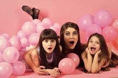 Kids face skin care. Portrait girl face in your advertisnent. Family, children, mother with party balloons.