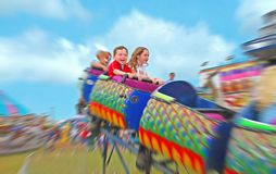 Kids on Fair Ride Stock Images