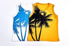 Kids fashion design sleeveless t-shirts. Collection of childrens cotton printed t-shirts, white background. High quality trendy summer clothes for kids Royalty Free Stock Photography