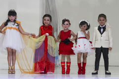 Kids fashion show. Children demonstrating clothes  at the Kids fashion show in the city of Solo, Central Java, Indonesia Stock Photos