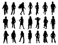 Kids fashion show. Twenty one silhouettes of kids models at fashion show. Isolated white background. EPS file available Royalty Free Stock Images