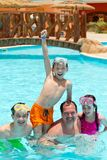 Kids and father in pool. Three kids with father in a swimming pool Stock Image