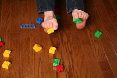 Kids feet pickup up blocks Royalty Free Stock Photography