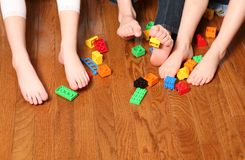 Kids feet pickup up blocks Royalty Free Stock Photo