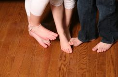 Kids feet on wood floor Royalty Free Stock Images