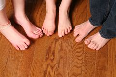 Kids feet on wood floor Stock Photo