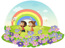 Kids in a field chasing insects Royalty Free Stock Images