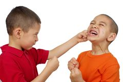 Kids fighting. Two boys fist fighting, seven and eight years old, on pure white background Stock Photography