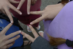 Kids fingers making a star. Kids making a star shape with fingers Stock Photos