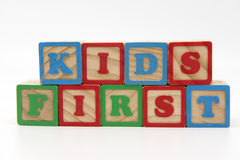 Kids First. Wooden blocks spelling kids first, conceptual idea that children's best interest should be in mind when dealing with separation and divorce Stock Photo
