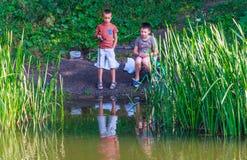 Kids fishing Stock Images