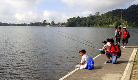 Kids fishing. One day at bedugul bali, kids fishing around temple at bratan lake Royalty Free Stock Photo