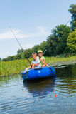 Kids fishing at the river. Summer vacation - Sister and brother fishing at the river Stock Photo