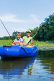 Kids fishing at the river. Summer vacation - Sister and brother fishing at the river Royalty Free Stock Image