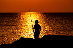 Kids Fishing Silhouette in Sunset Royalty Free Stock Images