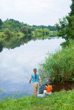 Kids fishing. Summer vacation - Sister and brother fishing at the river Stock Photos