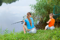 Kids fishing. Summer vacation - Sister and brother fishing at the river Stock Photo