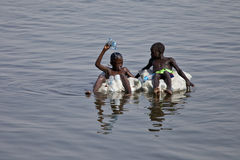 Kids floating down the nile Stock Image