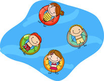 Kids floating on inflatable rings Stock Images
