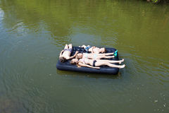 Kids floating on the river Royalty Free Stock Photography