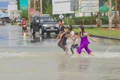 Kids in Flood. Kids having fun with the water. Heavy rains cause irregular flood in Rantau Panjang, Malaysia - Thai borders stock photography