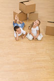 Kids on the floor in their new home Stock Image