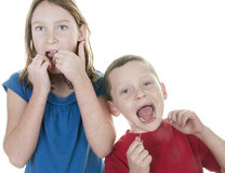 Kids flossing teeth Stock Images