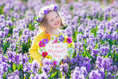 Kids with flowers and chalk board Stock Photos