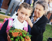 Kids with flowers on first school day in Moscow Royalty Free Stock Images