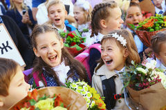 Kids with flowers on first school day in Moscow stock photos