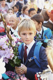 Kids with flowers on first school day in Moscow royalty free stock photos