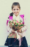 Kids with flowers on first school day in Moscow Stock Photography