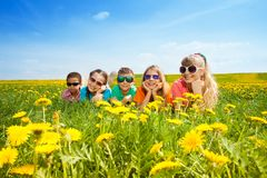 Kids in flowers Royalty Free Stock Photo