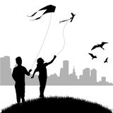 Kids flying kite Stock Photography