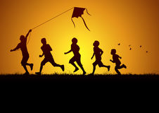 Kids flying a kite Stock Images