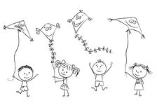 Kids with flying kites Royalty Free Stock Images