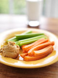 Kids food - peanut butter with celery and carrots. Peanut butter with celery and carrots and glass of milk royalty free stock photography