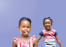 kids fooling around playing with blank purple background royalty free stock photo