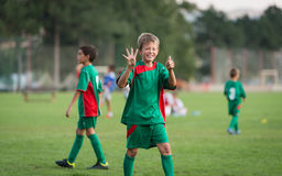 Kids football match. Little boy showing result on football match Royalty Free Stock Photo
