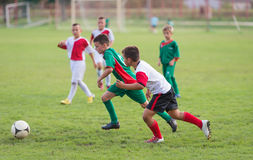 Kids football match Royalty Free Stock Photos