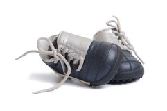 Kids football shoes. Silver blue kids football shoes with white shoelaces isolated on white background Royalty Free Stock Photo