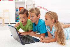 Kids found something interesting on laptop. Computer studying it Stock Photo