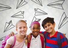 Kids friends in front of bright wall with paper airplanes graphics. Digital composite of Kids friends in front of bright wall with paper airplanes graphics Stock Photos