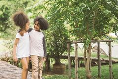 Kids Friendship. Children Friendship Togetherness Smiling Happiness Concept.Cute african american little boy and girl hug each other in summer sunny day Royalty Free Stock Photo