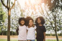 Kids Friendship. Children Friendship Togetherness Smiling Happiness Concept.Cute african american little boy and girl hug each other in summer sunny day Stock Photography