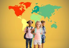 Kids in front of colorful world map. Digital composite of Kids in front of colorful world map Royalty Free Stock Photography